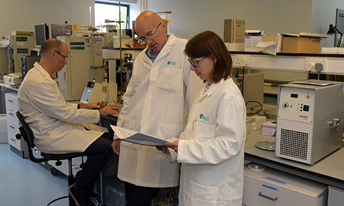 Three EPP chemists discussing their work in the EPP laboratory